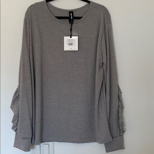 NWT ruffle top pullover